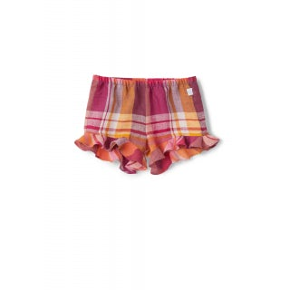pure linen baby girl shorts with valance on the bottom.